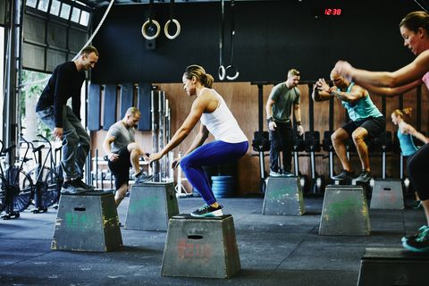 group-of-friends-doing-box-jumps-during-workout-royalty-free-image-1573752344.jpg