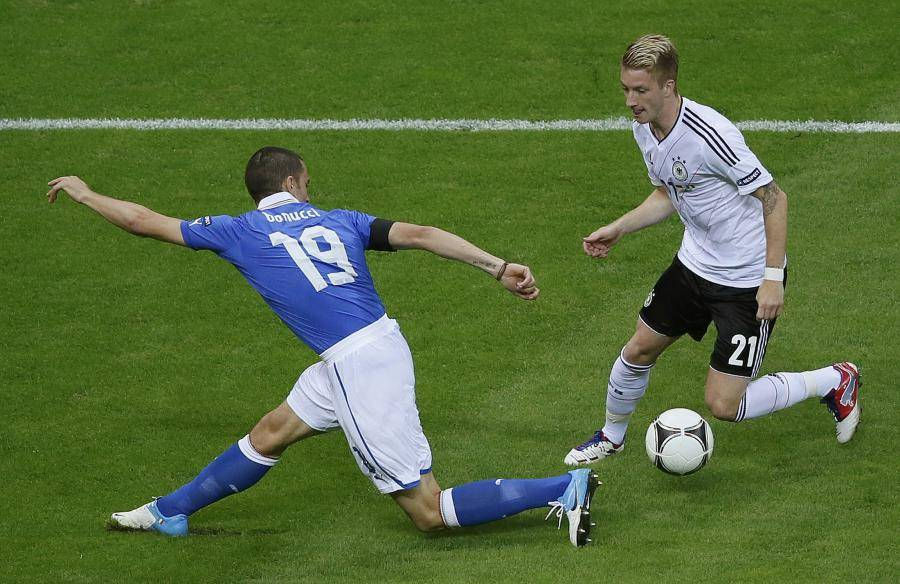 nged-by-italy-s-bonucci-during-their-euro-2012-semi-final-soccer-match-at-th-20120628220926-5819.jpg